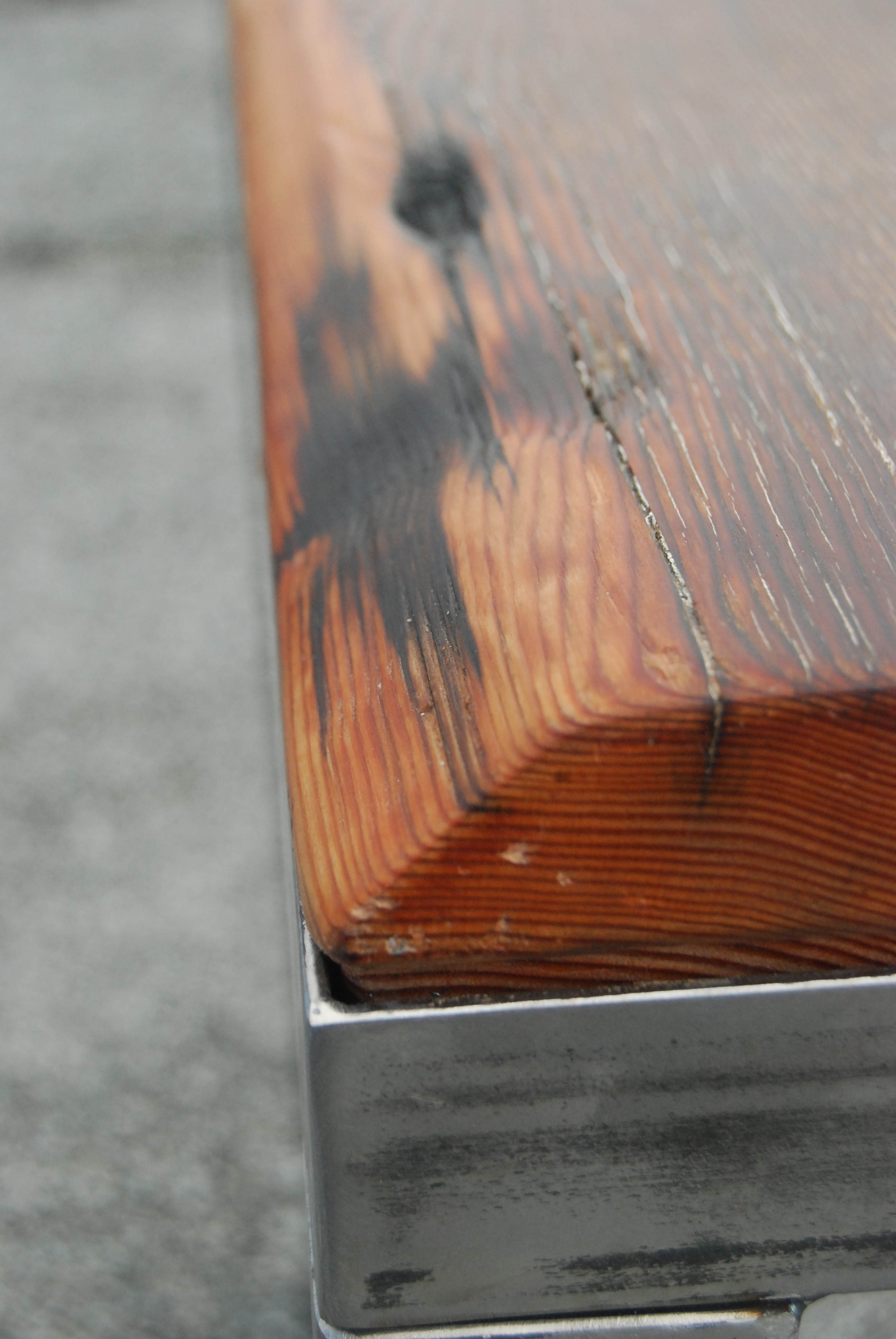 Salvaged Douglas Fir Top. Rough Polished Steel Carriage. Wax Finish.